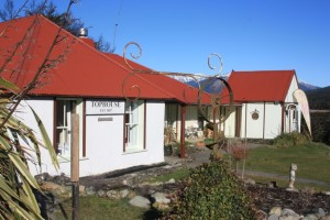 Side image of Tophouse Inn with snowy ranges in the background